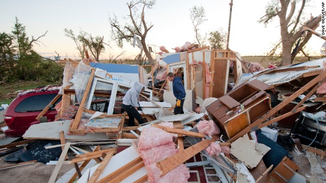 Matt and Traci Krus salvage items from their tornado-damaged home on October 5 in Wayne, Nebraska.