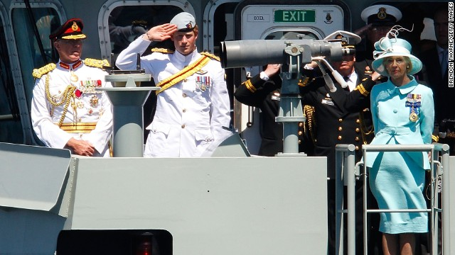 Prince Harry salutes aboard the Australian warship HMAS Leeuwin during the International Fleet Review in Sydney on October 5, 2013.