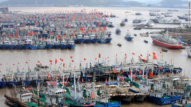 Fishing boats berth in Zhoushan port to avoid the powerful typhoon Fitow in Zhoushan, in east China's Zhejiang province on October 5, 2013.