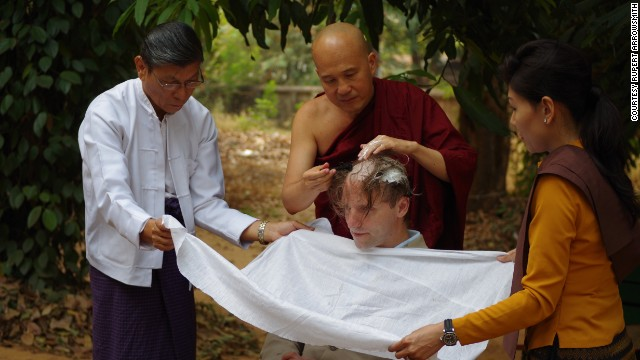 Rupert Arrowsmith has his head shaved upon entering the Chanmyay Yeiktha retreat.