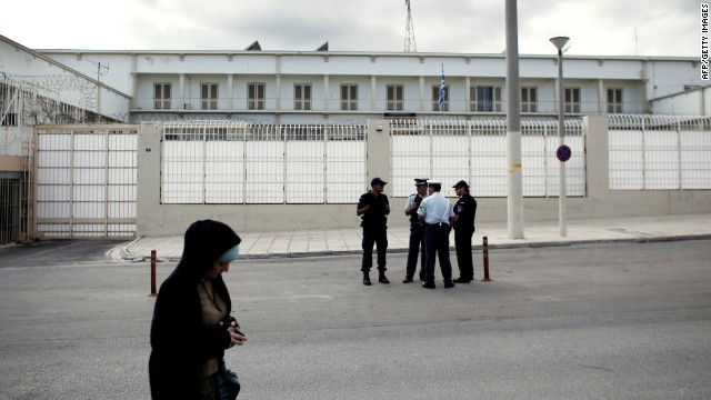 Police stand in front of the Korydallos high-security prison on October 3, 2013 before the transfer of Michaloliakos, pending his trial on criminal charges.