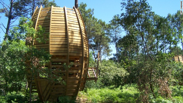 The resemblance of Cap Cabane's tree houses, in a forest near Bordeaux, France, to giant-squirrel food is meant to make them blend into the background -- sort of.