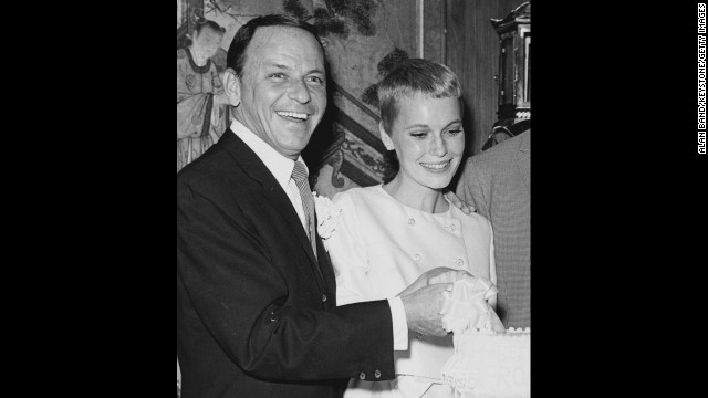 Frank Sinatra and Mia Farrow cut their wedding cake in Las Vegas in July 1966. They were married for 18 months.