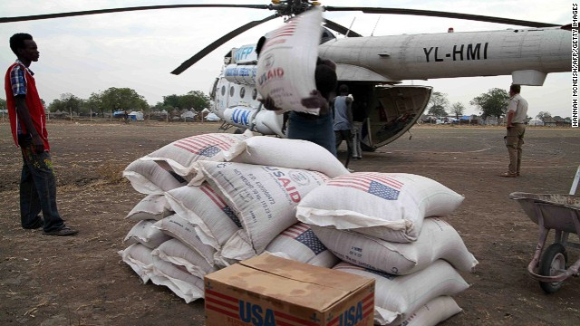 People in Jonglei state, South Sudan, unload aid from the U.N. World Food Program in January 2012.