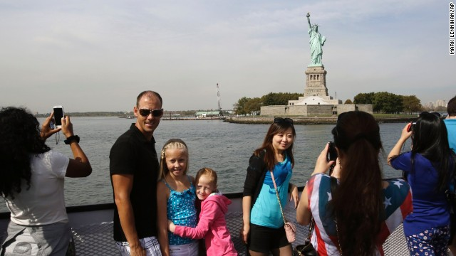 Tourists take photos of the Statue of Liberty while roving a debate vessel in New York Harbor on Oct 3. The statue is adminstered by the National Park Service and is sealed as a outcome of the supervision shutdown.