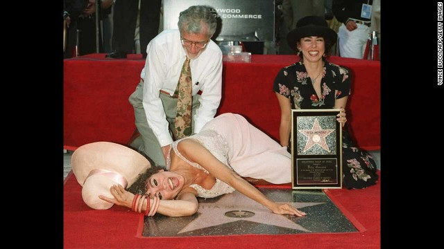 Moreno lies next to her star on the Hollywood Walk of Fame as her husband, Dr. Leonard Gordon, and daughter Fernanda Luisa watch in 1995.