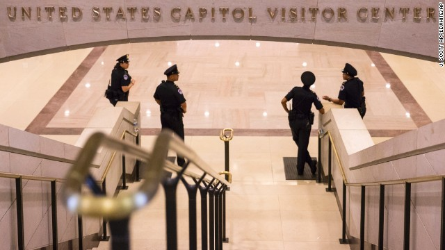 Officers mount at the bottom of stairs heading to the Capitol Rotunda on Monday, Oct 7.