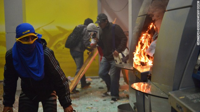Masked protesters destroyed cash dispensers during the Rio protests on October 7.