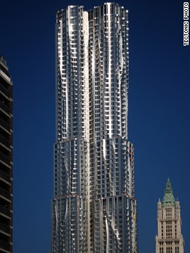 The facade of the skyscraper is composed of 10,500 stainless steel panels, some flat, some undulating. In order to better integrate the eye-catching building into its urban context, the bottom five stories of the tower are clad in brick. <strong>Architect</strong>: Frank O. Gehry