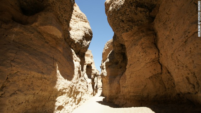 Although the desert is mostly flat, there are some scenic canyons, such as the Sesriem Canyon, pictured.