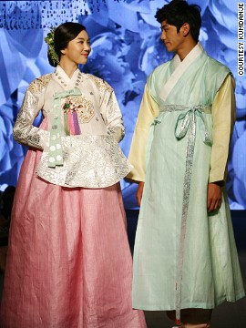 Korean couples usually have hanbok made for their weddings. These days, many are opting for the royal style of hanbok, shown here.