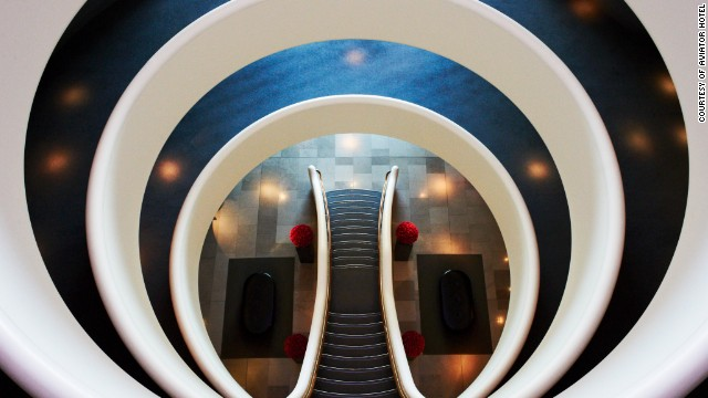 Inspired by the company's aviation business, this hotel's curving walls are reminiscent of airline engines.