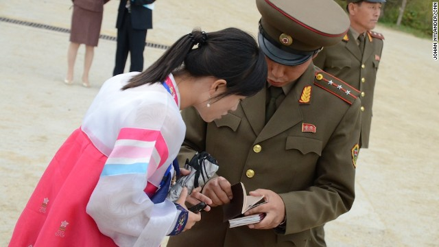 Custom official and tourist bureau guide checking foreigners' passports.