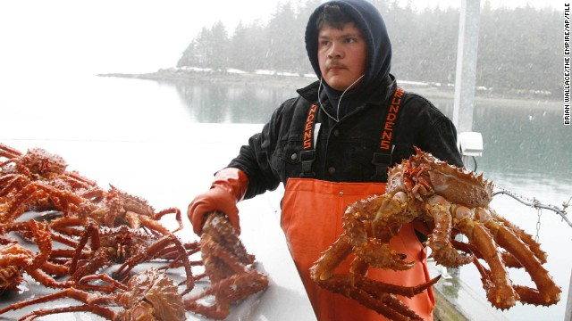 A man sorts golden king crab in Auke Bay in Juneau, Alaska, in March 2007. The partial government shutdown has left crab fleets in limbo without any federal employees to set rules and quotas for the fishing season. A delay of even a few days could be costly, a congresswoman from Washington state warned in a House speech last week.