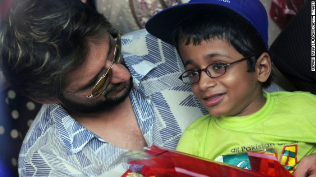 Former Pakistani cricket captain Shahid Afridi chats with a polio-afflicted child during a 'Make A Wish' event in Karachi 18 June, 2011.