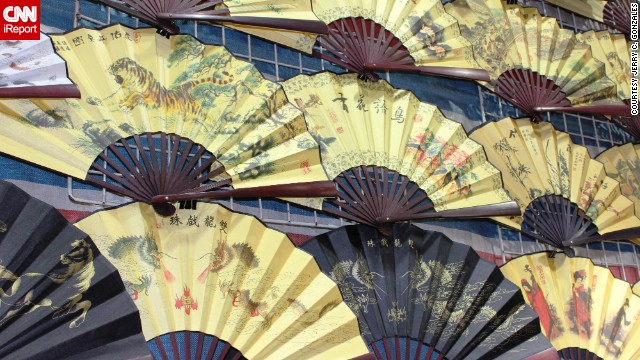 Handcrafted fans are some of the <a href='http://ireport.cnn.com/docs/DOC-776029'>many souvenirs</a> to be found in the street markets of Hong Kong's most crowded neighborhood.