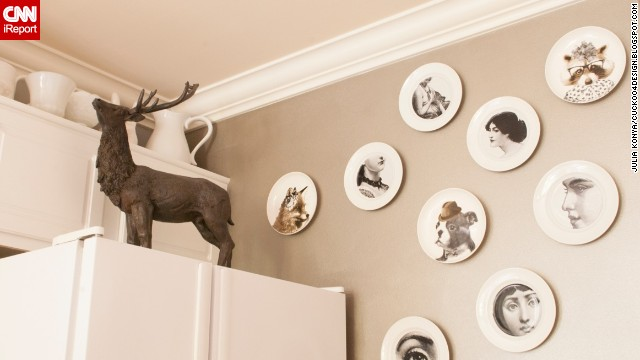 Konya's shows a <a href='http://cuckoo4design.blogspot.com/2013/09/winner-and-more-h.html' target='_blank'>collection of whimsical plates</a>, and a stern-looking reindeer atop her refrigerator.