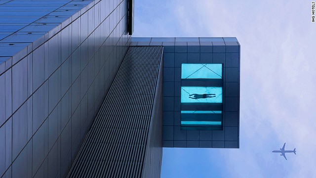 At the Holiday Inn Shanghai Kangqiao, the glass-bottomed pool, located on the 24th floor, measures 30 meters (98 feet) in length and half of the pool protrudes out from the building over the street below.