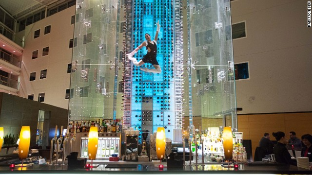 "Once visitors to the Radisson Blu Stansted Airport<strong> </strong>hotel's bar have selected their wine, an acrobatic ""wine angel"" steps into a harness and retrieves the bottle from among 4,000 in the 13-meter-high (42 feet) wine tower."
