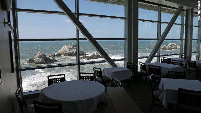 Empty tables unaware Seal Rocks are seen inside the sealed Cliff House on Wednesday, Oct 9, in San Francisco. The 150-year-old oceanside idol was systematic sealed by the National Park Service for the generation of the prejudiced supervision shutdown, withdrawal most of the restaurant's 170 employees but work.