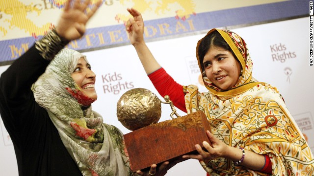 Malala receives a trophy from Yemeni civil rights activist and 2011 Nobel Peace Prize winner Tawakkul Karman after being honored with the International Children's Peace Prize in the Hague, Netherlands, on September 6.