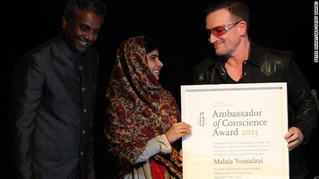 Musician Bono and Secretary General of Amnesty International Salil Shetty honor the teen with the Amnesty International Ambassador of Conscience Award for 2013 at the Manison House in Dublin, Ireland, on September 17. The award is Amnesty International's highest honor, recognizing individuals who have promoted and enhanced the cause of human rights.