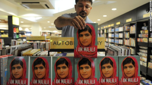 A man arranges Malala's memoir, 'I Am Malala' at a bookstore in Ahmedabad, India, on October 9. The book marks the anniversary of her shooting, it follows her journey from near-death to global fame.