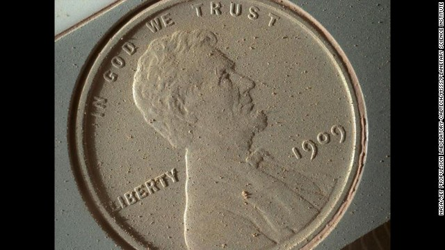 Martian dust appears on the surface of a penny, brought along with the Curiosity rover and photographed by the Mars Hand Lens Imager on October 2. The image of the 1909 coin is at the highest resolution possible for the high-powered camera -- 14 micrometers per pixel (a micrometer is about .000039 inches).