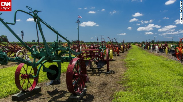 "More than 500 brightly colored tractors and plows are on display in the ""field of plows"" at the Schneider Farm in Chesaning, Michigan. Many are more than 100 years old, renovated by Elmer Schneider himself."
