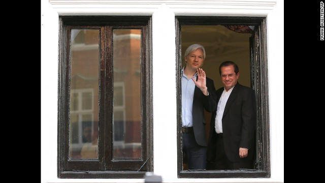 Assange appears with Ecuadorian Foreign Minister Ricardo Patino on the balcony of the embassy on June 16, 2013.