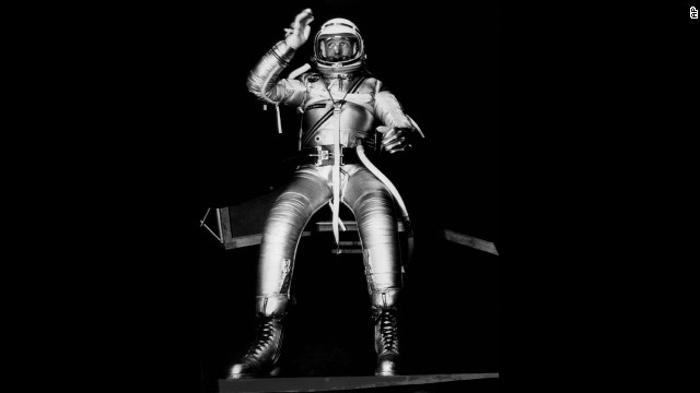 Carpenter, one of seven men being trained for space flight, tests the mobility of a full pressure suit being developed for use by the Project Mercury trainees. The suit was a prototype designed to protect the astronauts from heat and pressure conditions expected to be encountered during flight. The tests were conducted at the Navy Air Material Center in Philadelphia, Pennsylvania, on November 23, 1959.