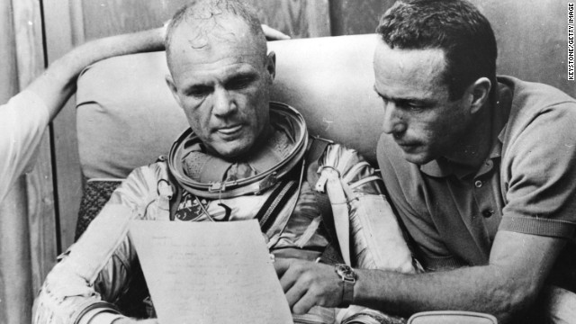 Glenn, left, checks over notes with back-up pilot Carpenter after a simulated flight before the Mercury-Atlas 6 mission at Cape Canaveral in 1962.