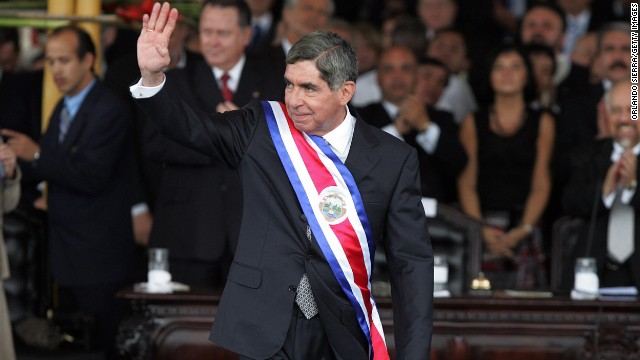 Then-Costa Rican President-elect Oscar Arias waves to supporters after receiving the ceremonial sash at the National Stadium in San Jose on May 8, 2006. Arias won the Nobel Peace Prize in 1987.