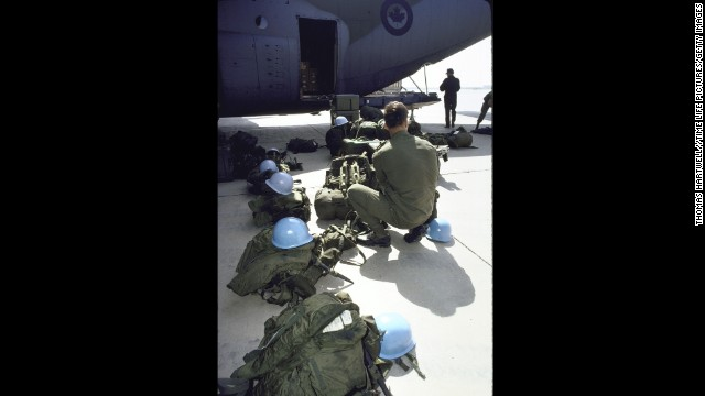 U.N. soldiers unload their gear from a C-130 cargo plane as the U.N. observer team policing the Iran-Iraq cease-fire arrives in Baghdad. The United Nations Peacekeeping Forces won the Nobel Peace Prize in 1988.