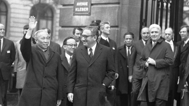 Hanoi's delegate Le Duc Tho cheers to the crowd while leaving the International Conference Center in Paris on January 23, 1973, after meeting with presidential adviser Henry Kissinger, center. Le Duc Tho and Kissinger won the Nobel Peace Prize in 1973.