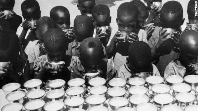 Children drink milk handed out by UNICEF workers in Moundou, Chad, on October 26, 1965. UNICEF won the Nobel Peace Prize in 1965.