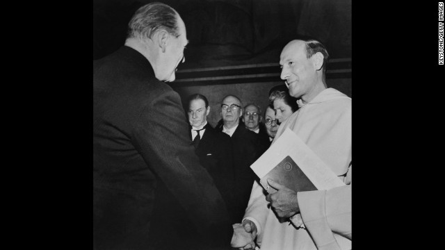 Georges Pire, right, receives the Nobel Peace Prize in 1958, for his efforts to help European refugees leave their camps and return to a life of freedom and dignity.