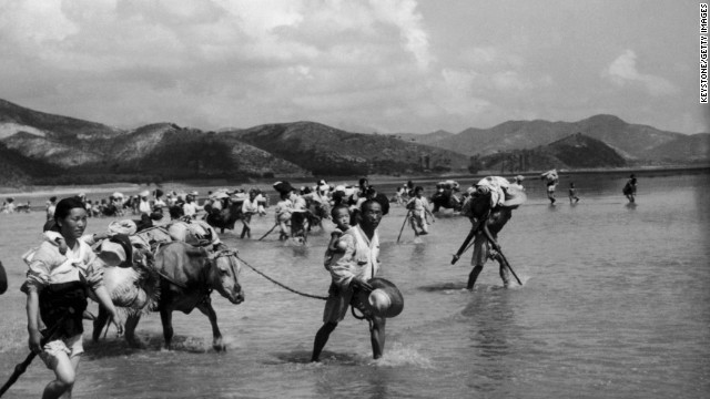 North Korean refugees cross the Naktong River, three miles south of Waegwan in South Korea, on August 6, 1950, just a short time before the beginning of the conflict between North and South Korea. The U.N. forces in Korea had set a time limit of 15 hours for crossing the river. In 1954, the Nobel Peace Prize was awarded to the UNHCR, the Office of the United Nations High Commissioner for Refugees.