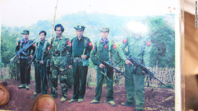 In this photo, Soe Paing's son Zaw Zaw Lin stands second from the right. He wears a Myanmar military uniform and holds a gun. Zaw Zaw Lin spent more than three years in the army before he was freed.