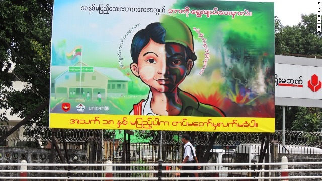 A sign recently erected in Yangon aims to raise awareness of the illegal recruitment of underage boys to the Burmese state military. It asks whether this boy should be in school or the army.