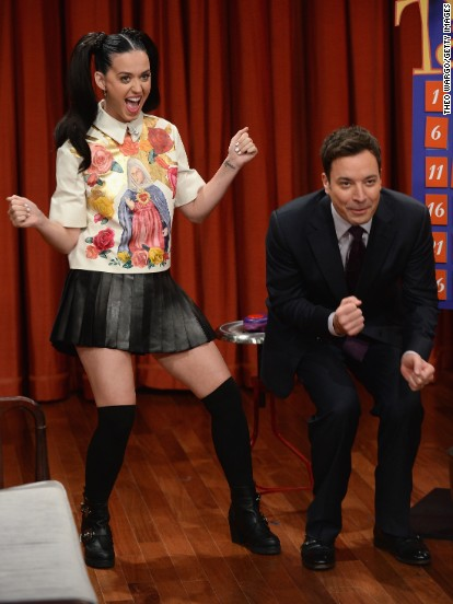 "Katy Perry and Jimmy Fallon have fun playing a game of Taboo during an October 10 taping of ""Late Night."""