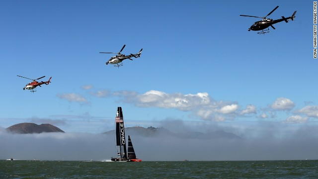 "Veteran sports photographer Ezra Shaw took to land, sea, and sky to capture these remarkable images of the America's Cup. ""Before each race, both teams would warm up by sailing most of the race course,"" the 39-year-old Getty photographer explained. ""The television helicopters would also start the day by flying in a close formation across the course."""
