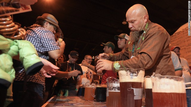 Tim Hawn, brewmaster for Dogfish Head Craft Brewery of Milton, Delaware pours beers for festival goers.