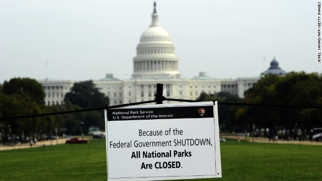 A closure sign is posted on the National Mall near the U.S. Capitol. Much of Washington remains closed with hundreds of thousands of government workers furloughed.