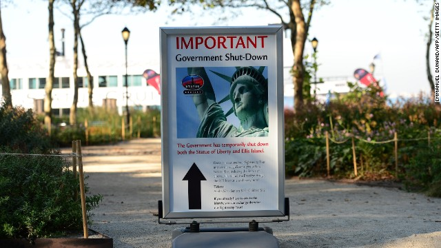 A sign announces that the Statue of Liberty is closed on October 1.