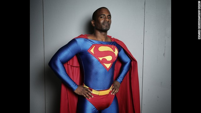 An attendee poses in the iconic Superman stance for the first day of New York Comic Con 2013 on Thursday, October 10.