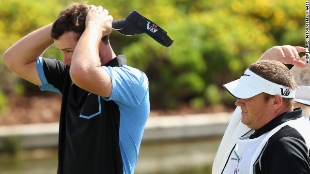 Scott Jamieson, left, reacts after he missed out on shooting a 59 at the Portugal Masters.