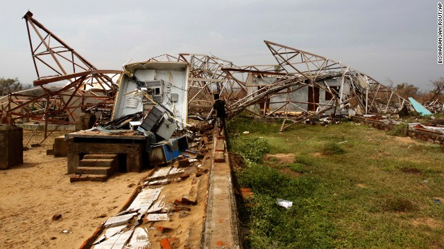 A man walks toward a damaged cellular phone tower in Berhampur on India's Bay of Bengal coast on October 13.
