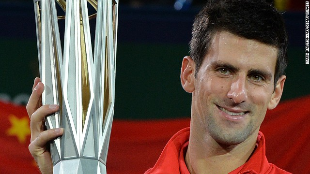 Novak Djokovic gets his hands on the Shanghai Masters trophy again after seeing off Juan Martin Del Potro in the final.