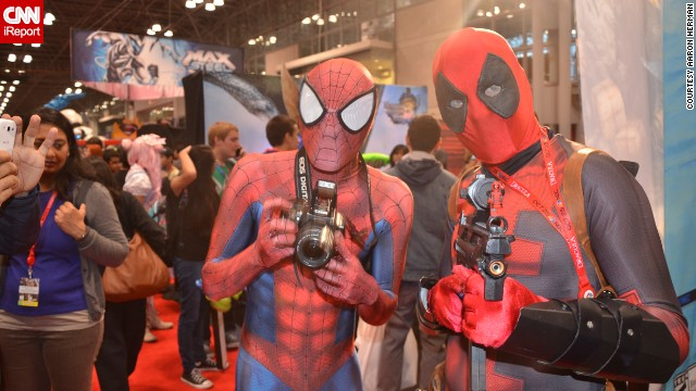 Popular Marvel Comics characters <a href='http://ireport.cnn.com/docs/DOC-1047487'>Spider-Man and Deadpool</a> pose with their accessories of choice.